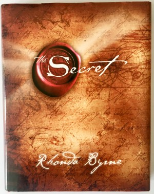 The Power of Positivity: How Positive Thinking Changed my Life. Image of The Secret book by Rhonda Byrne.