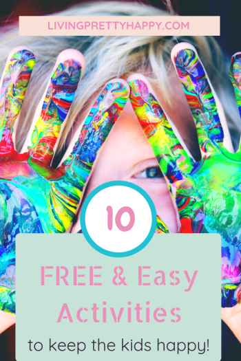 10 Free & Easy activities to keep the kids happy.  Pinterest graphic displaying post title on a background image of a young child holding the palms of their hands up to the camera covered in multi-coloured paint.  Livingprettyhappy.com