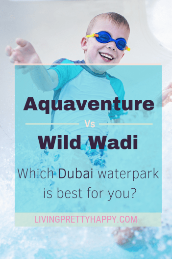 Aquaventure vs Wild Wadi - which waterpark is best for you? Pinterest graphic of young boy coming down a water slide wearing googles and swimwear smiling with water splashing everywhere. Livingprettyhappy.com