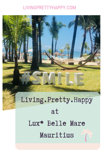 Living.Pretty.Happy at Lux* Belle Mare Mauritius. Pinterest graphic with image of palm trees in Mauritius with a hammock and a sign on the grass reading #smile.