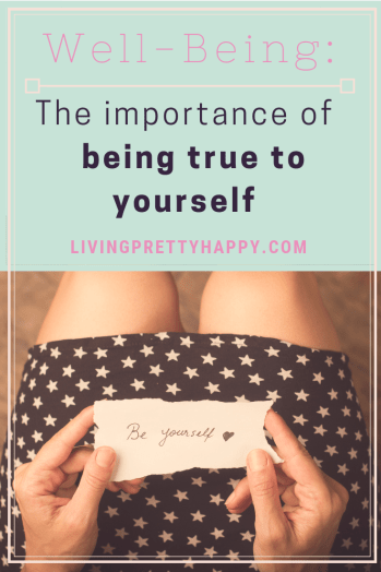 Being you: The importance of being true to yourself. Pinterest Graphic displaying the post title and a picture of a woman's legs and hands sitting down in a black dress with white stars holding a piece of torn paper with the words be yourself and a heart image on it. livingprettyhappy.com