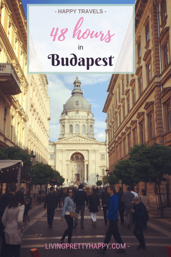48 hours in Budapest: Pinterest graphic displaying post title on a background image of a street leading to St Stephen's Basilica Alex Grace can be seen in the foreground. Livingprettyhappy.com happy travels