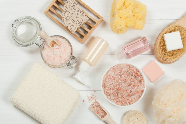 For the scrub of it: why should you exfoliate and how to do it right. Image of various types of exfoliating products including salt scrub, brushes, soaps and sponges