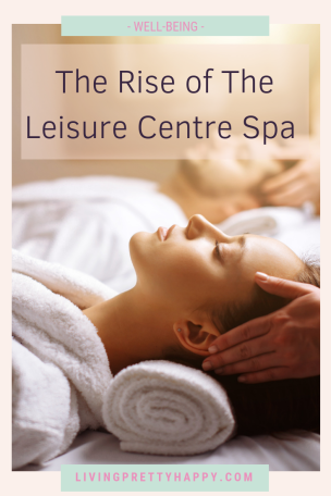 The Rise of the leisure centre day spa (Verulamium Spa, St Albans). Pinterest Graphic featuring post title on a background image of a woman and a man lying on 2 spa treatment tables receiving a scalp massage from 2 therapists. Well-being. Livingprettyhappy.com