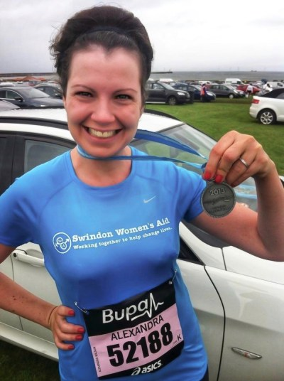 Why I run: my running story. Image of Alex Grace smiling and holding a 2013 Great North Run finishers medal