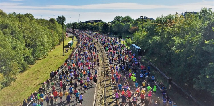 How to keep your running motivation. How to stay motivated to run. Image of runners taking part in Bupa Great North Run