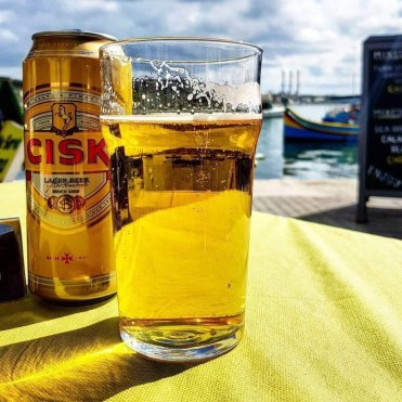 10 Things you should know about Malta - Going to Malta - 10 things you should know. Image of Cisk and a pint glass filled with Cisk