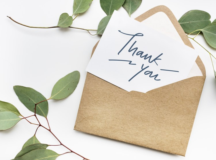 A Thousand Thanks: Why practising gratitude increases your happiness. Image of Thank You card in an envelope