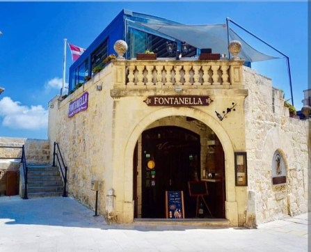 Happy Travels: Where you absolutely should go in Malta. Image of exterior of Fontanella Tea Garden