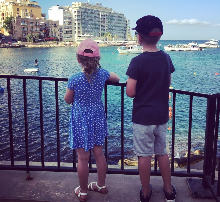 Image of 2 children looking out to sea in Malta