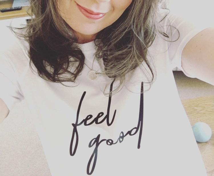How can clothes make you happy? Plus expert tips for more successful shopping. Image of Alex Grace wearing a white t-shirt with the words feel good written on it