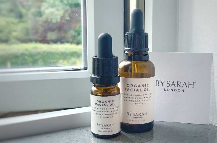 By Sarah London Organic Facial Oil Review - Image of 30ml & 10ml By Sarah London Facial oils on a windowsill
