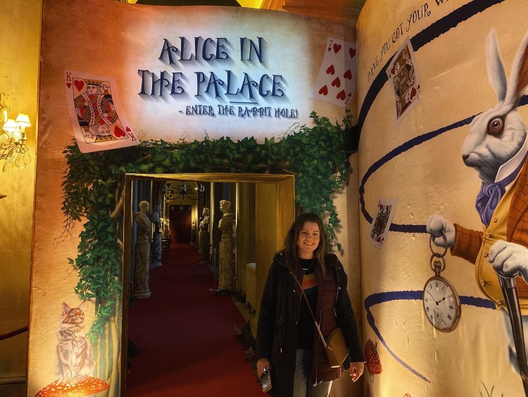 Alex Grace at the entrance to the Blenheim Palace, Alice in the Palace Experience