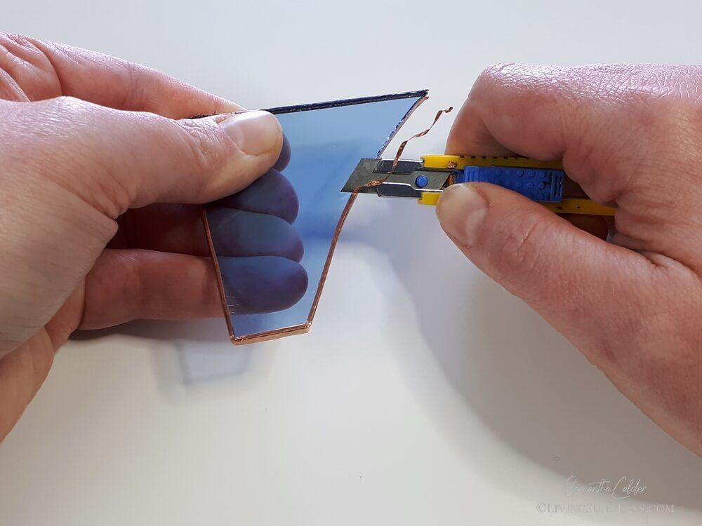 a craft knife is used to cut away poorly placed copper foil
