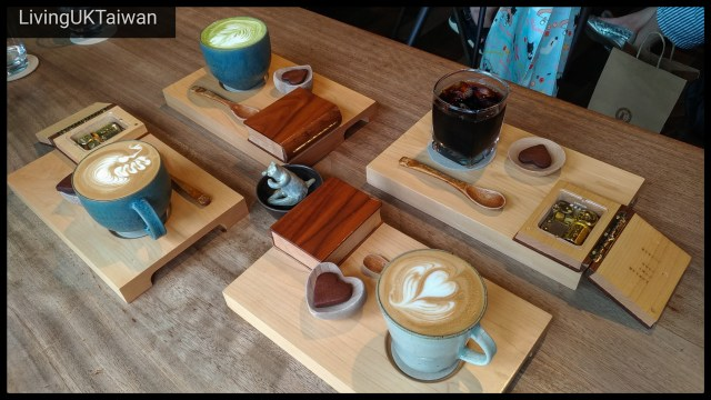 Four cups of coffee on a tray