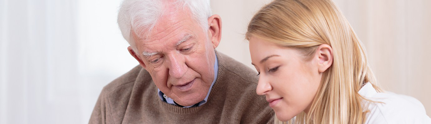 Elderly man talking to Living Well at Home