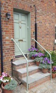 Older house with a simple adaptation of better steps and a simple painted handrail.