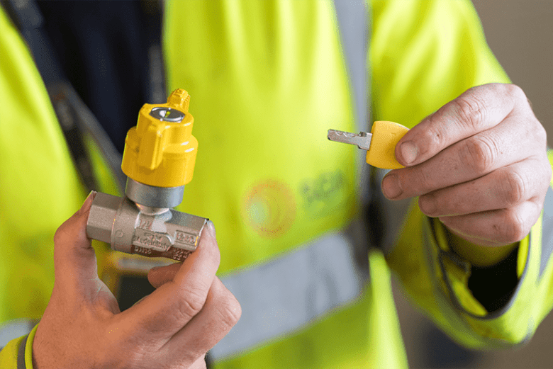 Image showing a Gas Engineer holding a Locking Cooker Valve