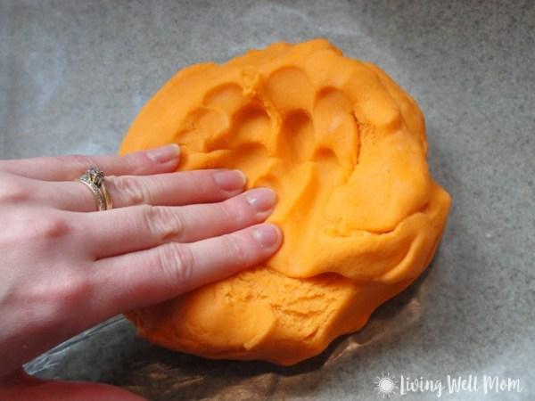 squishing homemade orange playdough