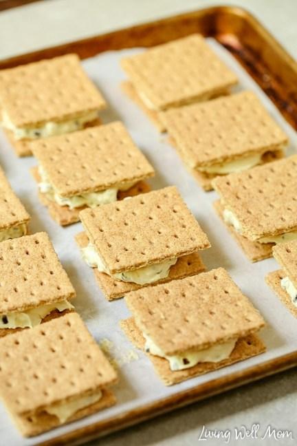 graham cracker ice cream sandwiches on a cookie sheet