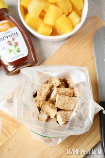 chicken strips in zippered bag with pineapple and honey