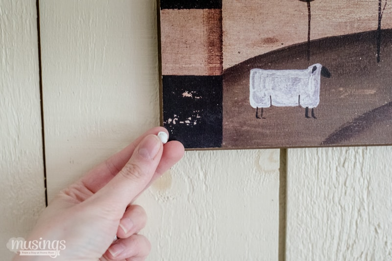 Say good-bye to uneven, crooked picture frames with this easy picture hanging tip.