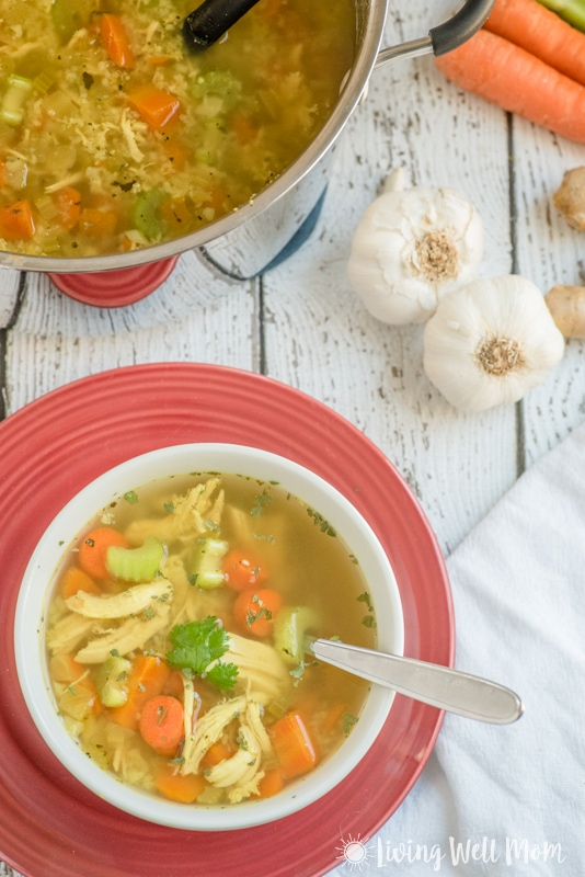 This easy-to-make homemade Paleo Chicken Soup recipe is gluten-free, grain-free, and dairy-free, and is so delicious, even kids gobble it up and ask for more! It's packed with nutrients and herbs that can help nourish and warm! #chickensoup #chickensouprecipes