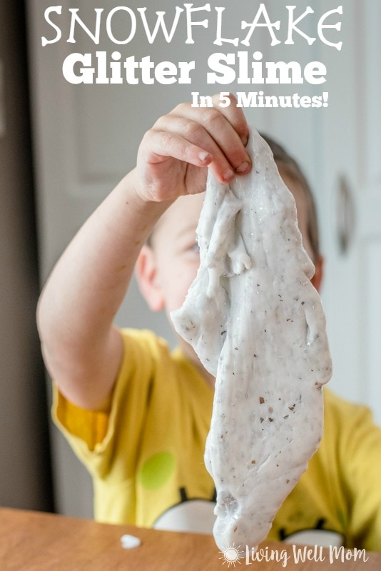 Are the kids bored? This fun recipe for Snowflake Glitter Slime takes just 5 minutes to make and is so easy, kids 6 and older can help make it themselves! Homemade slime is also great for sensory play and calming autistic children! Find out how to make it here: