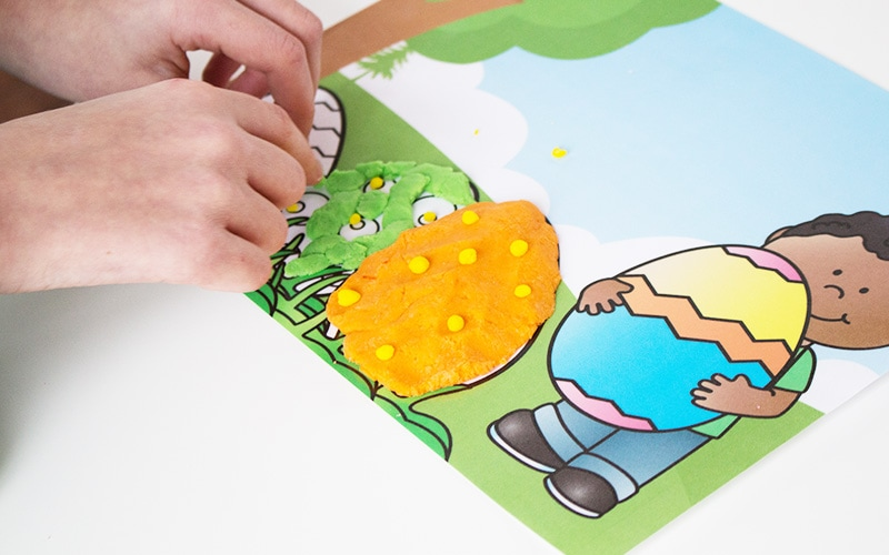 """Need a fun Easter activity for your kids? These adorable Easter Egg Playdough Mats provide hours of fun as children """"decorate"""" their eggs with playdough and there's none of the mess of real egg decorating! Download these free printable playdough mats here."""