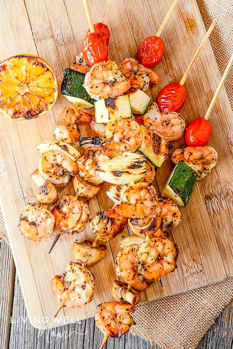 grilled shrimp skewers with garlic marinade and vegetables