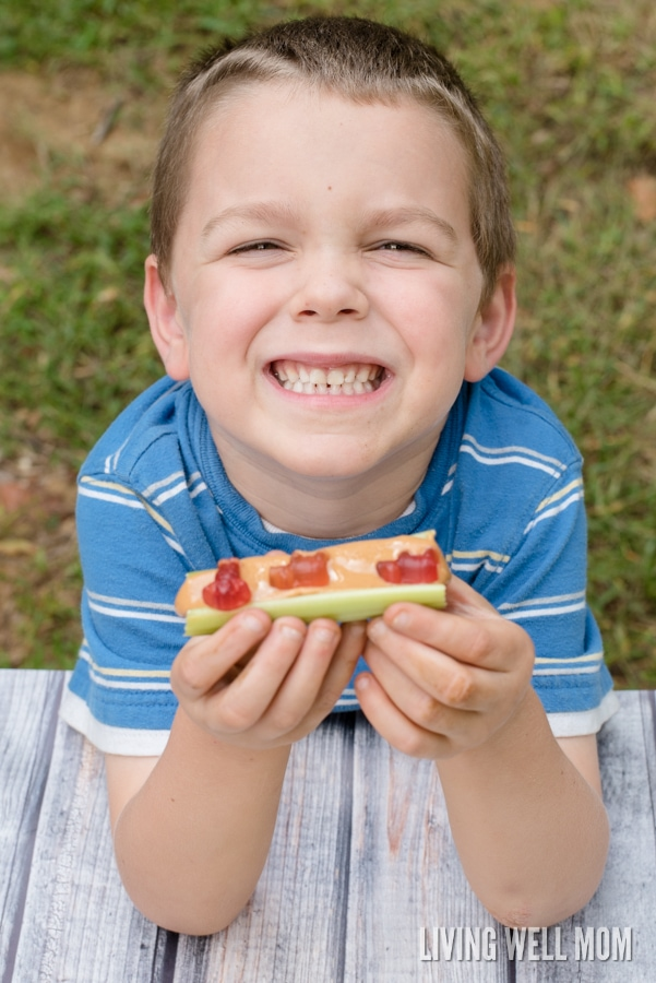 Get kids to eat their veggies with this fun Celery and Peanut Butter snack with a twist! Kids love it and so do moms!