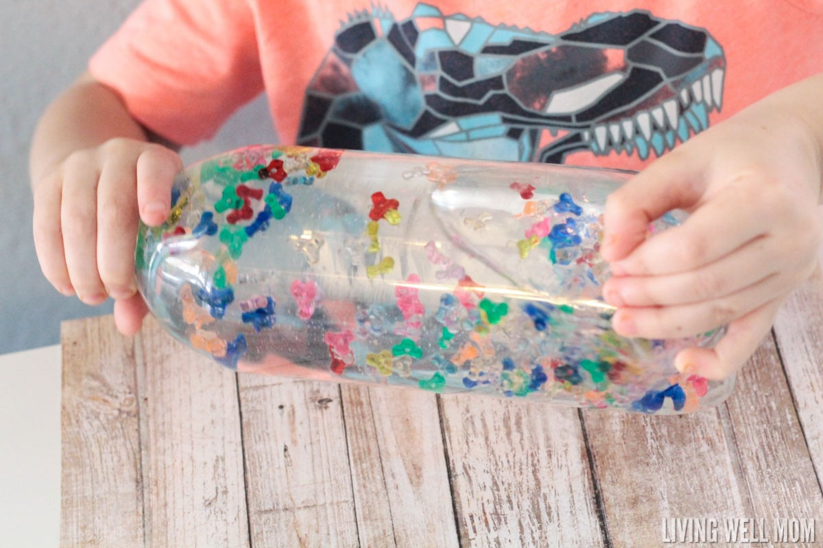 Kids of all ages love this Rainbow Sensory Bottle! It's calming for kids with autism and also works well as a timer or distraction for young children. Find out how to make your own with the easy DIY instructions here.