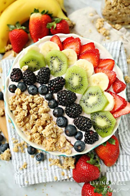 rainbow acai bowl with granola, fruit, and yogurt