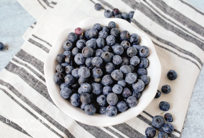 fresh blueberries in a bowl with a striped napkin