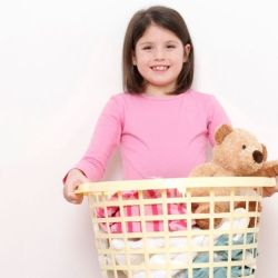 girl holding laundry basket