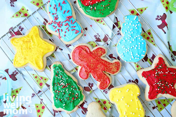Christmas frosted gluten-free sugar cookies on a wire rack