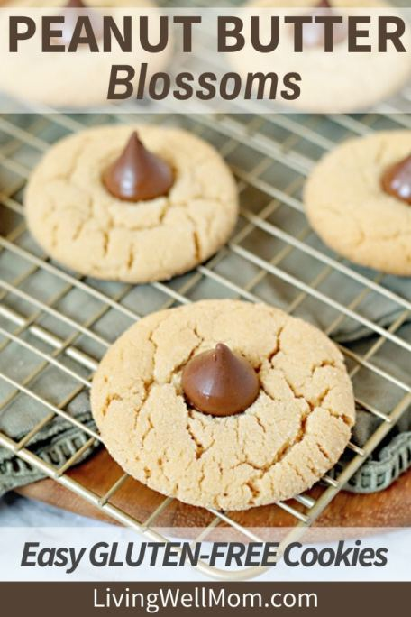 gluten-free peanut butter blossoms with hershey's kisses cooling on wire rack