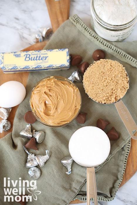 ingredients for peanut butter blossoms - peanut butter, butter, sugar, flour