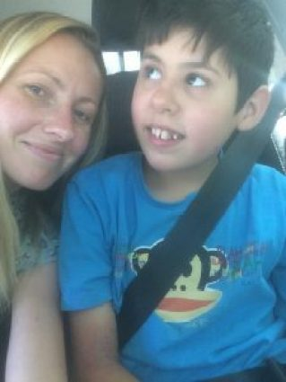 Jude and myself sitting in the car smiling.