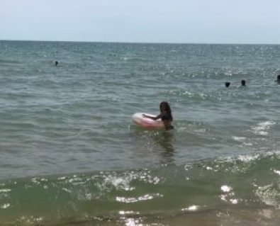 Elsa in the sea on her inflatable doughnut