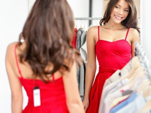 woman-trying-on-dress-with-tag
