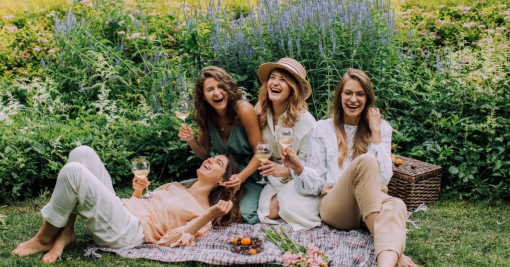 group-of-girlfriends-laughing-on-picnic