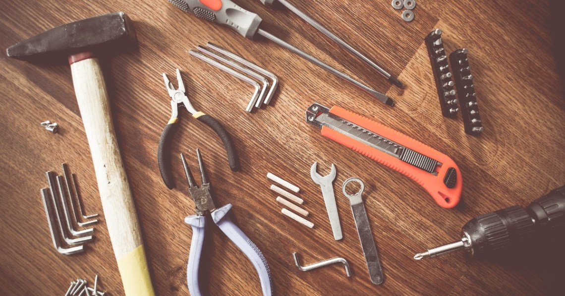 assorted-tools-on-wooden-table