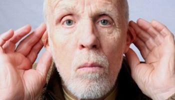 man-hands-behind-ears
