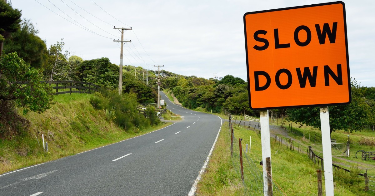 slow-down-road-sign