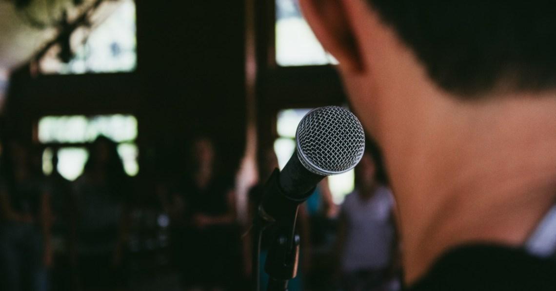 man-speaking-microphone