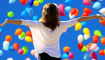 woman-outstretched-arms-balloons