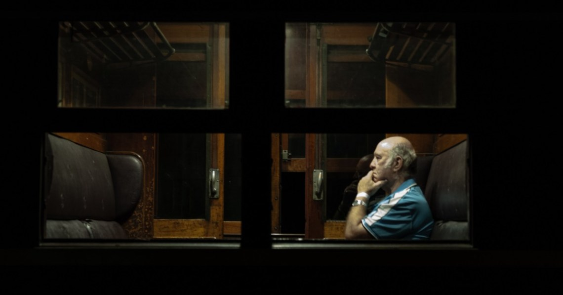 man-alone-viewed-through-window