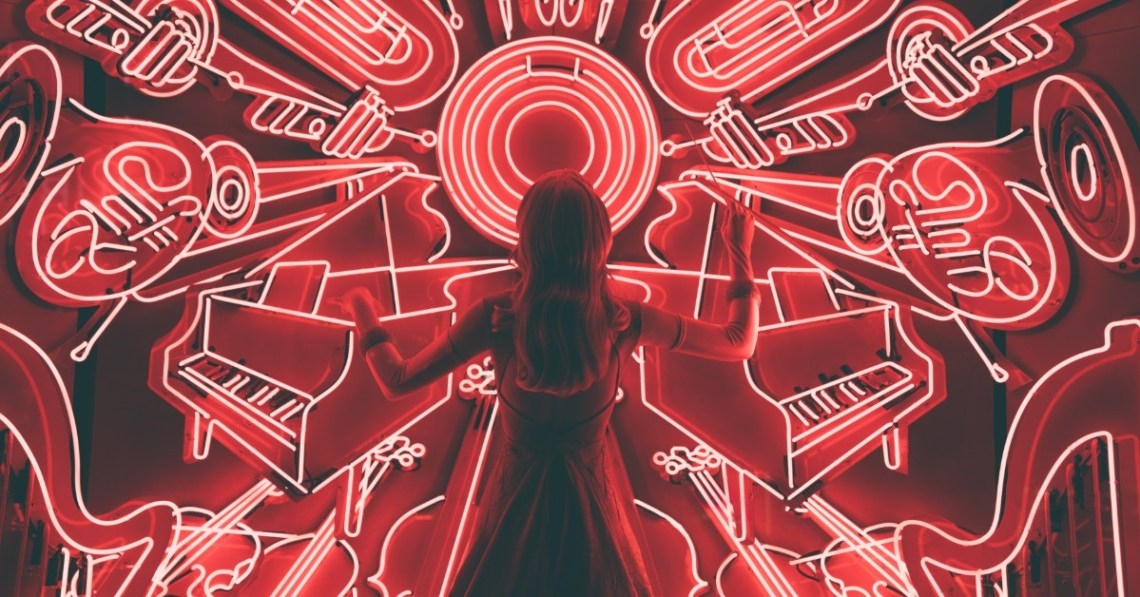 woman-surrounded-by-musical-instruments