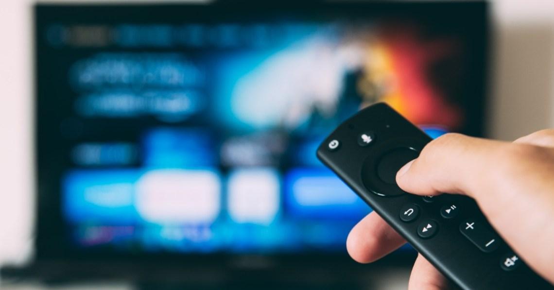 person-holding-TV-remote